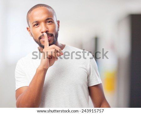 young cool black man silence sign - stock photo
