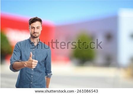 young cool man with okay gesture - stock photo