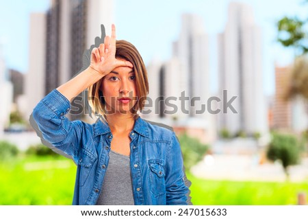 young cool woman loser sign - stock photo