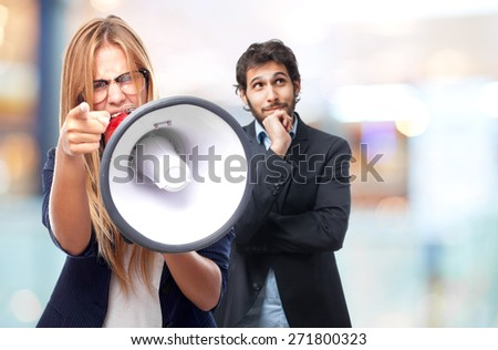 young cool woman ordering at megaphone - stock photo