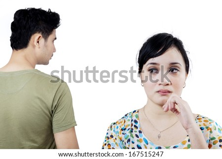 Young couple after quarrel. Isolated on white background - stock photo