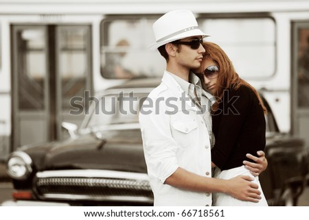 Young couple against a city traffic. - stock photo
