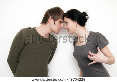 Young Couple Arguing Conversation, they menace each other - stock photo