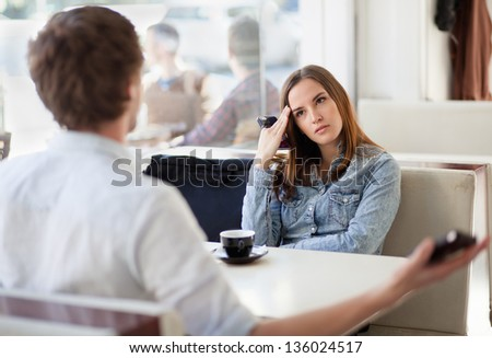 Young couple arguing in a cafe. Relationship problems. - stock photo