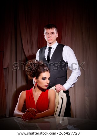 Young couple at ancient room (normal version) - stock photo