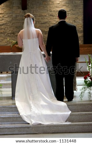 Young couple at the altar about to get married. - stock photo