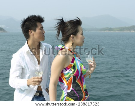 Young Couple at Yacht Party - stock photo
