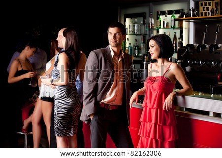 young couple bar counter having fun smile - stock photo