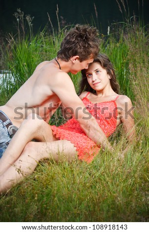 Young couple being very close to each other - stock photo