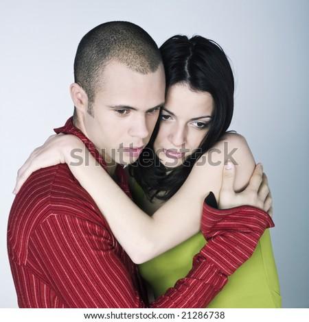 young couple bonding on isolated background - stock photo