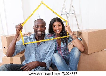 Young couple buying new home - stock photo