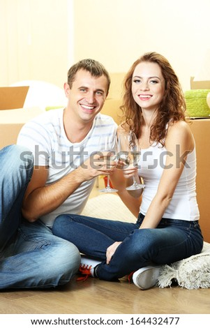 Young couple celebrating moving to new home  - stock photo