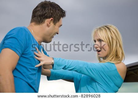 Young couple - conflict in relationship, problems, harassment, disagreement - stock photo
