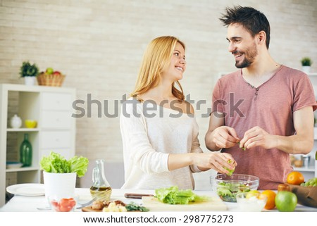 Young couple cooking breakfast together - stock photo