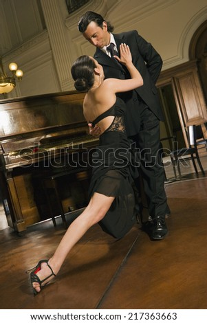 Young couple dancing at a party - stock photo