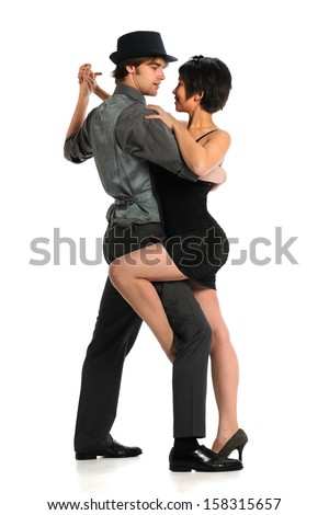 Young couple dancing tango isolated over white background - stock photo