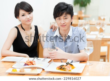 Young couple dating at a restaurant for a romantic dinner - stock photo