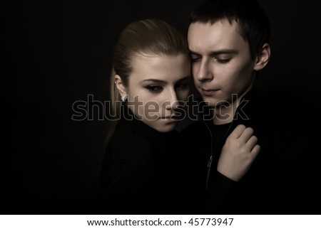Young couple: dramatic portrait - stock photo