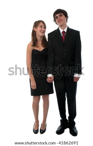 Young couple dressed up in formal wear for prom night date. - stock photo