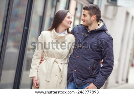 Young couple embracing in a walk - stock photo