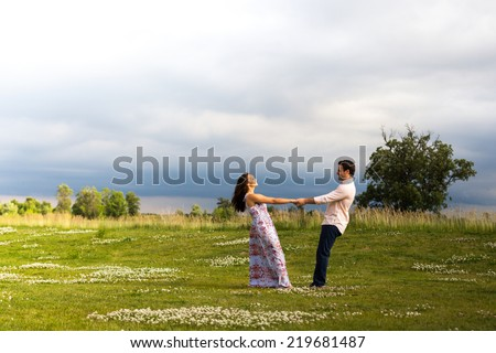 Young couple engagement photos outdoors - stock photo