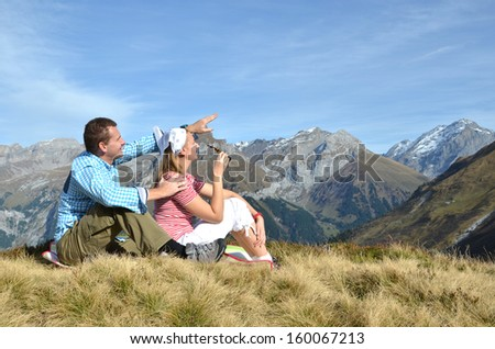 Young couple enjoying Alpine panorama. Switzerland - stock photo