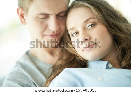 Young couple enjoying presence of one another - stock photo