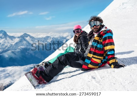 young couple enjoying winter mountains, Les 2 Alpes, French Alps,  - stock photo