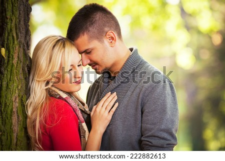 Young couple enjoying worm autumn day in nature - stock photo