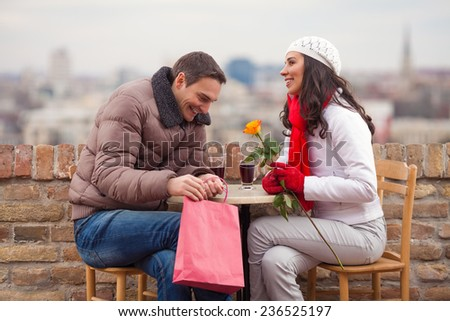 Young couple exchanging gifts for Valentine's Day - stock photo