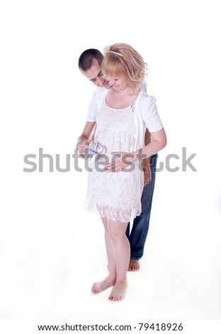 Young couple expecting a baby - stock photo