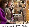 Young couple exploring and shopping indoor market. Pike Market. Seattle. - stock photo