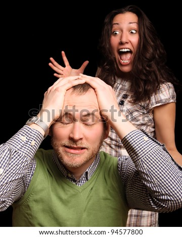 young couple fighting. she's a pain in the neck - stock photo