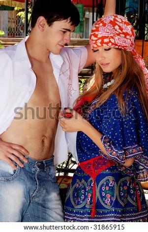 young couple flirting, outdoor shot - stock photo