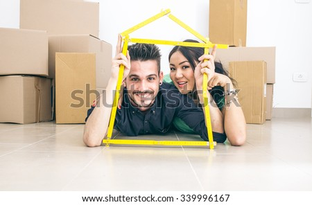 Young couple getting new house. concept about people and real estate business - stock photo