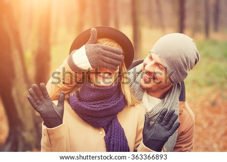 Young couple hanging out in the forest. - stock photo