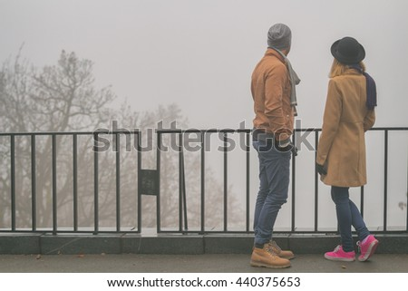 Young couple hanging outdoors. - stock photo