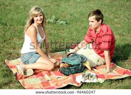 young couple has a picnic - stock photo