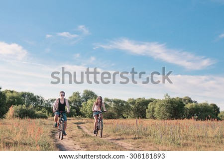 young couple having a bike ride in nature - stock photo