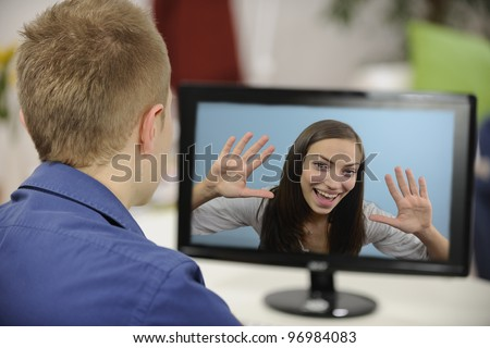 Young couple having a video conference - stock photo