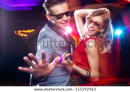 young couple having fun dancing at  party. - stock photo