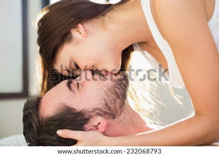 Young couple having fun in bed at home in bedroom - stock photo