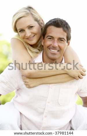 Young couple having fun in countryside - stock photo