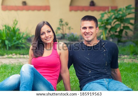 Young couple having fun in the garden on beautiful spring day. - stock photo