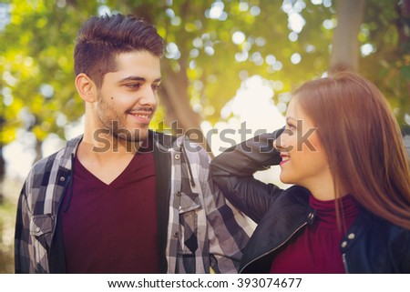 Young couple having fun in the park, selective focus - stock photo