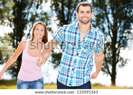 Young couple having fun outside. - stock photo
