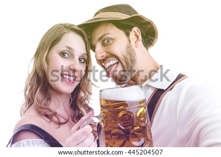 Young couple having fun with german beer - stock photo