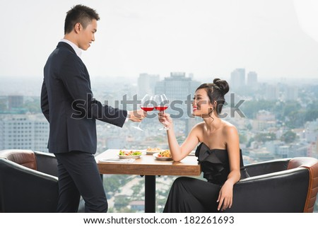 Young couple having luxury romantic date at a restaurant  - stock photo