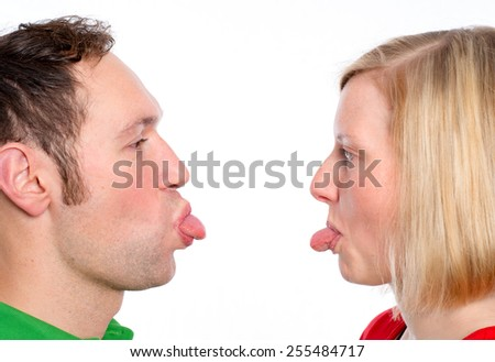 young couple heaving fun and poke the tongue out - stock photo
