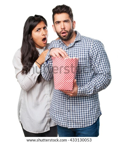 young couple holding a popcorn - stock photo